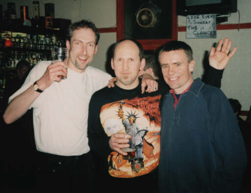Nick John, Lee Burrows and ex-roadie and friend Alan Bull at a London Praying Mantis Gig